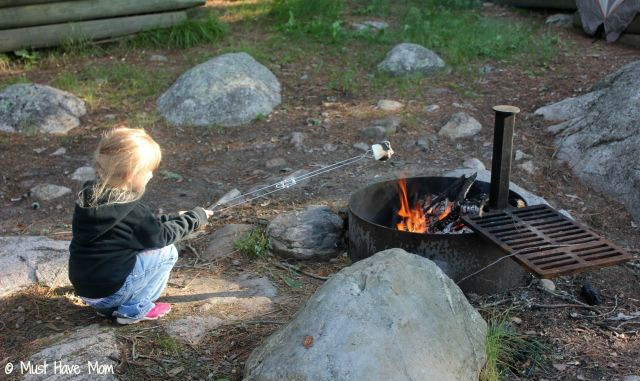 Danika roasting a S'more - Must Have Mom