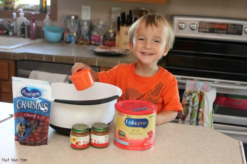 Carson helping make muffins using Enfagrow