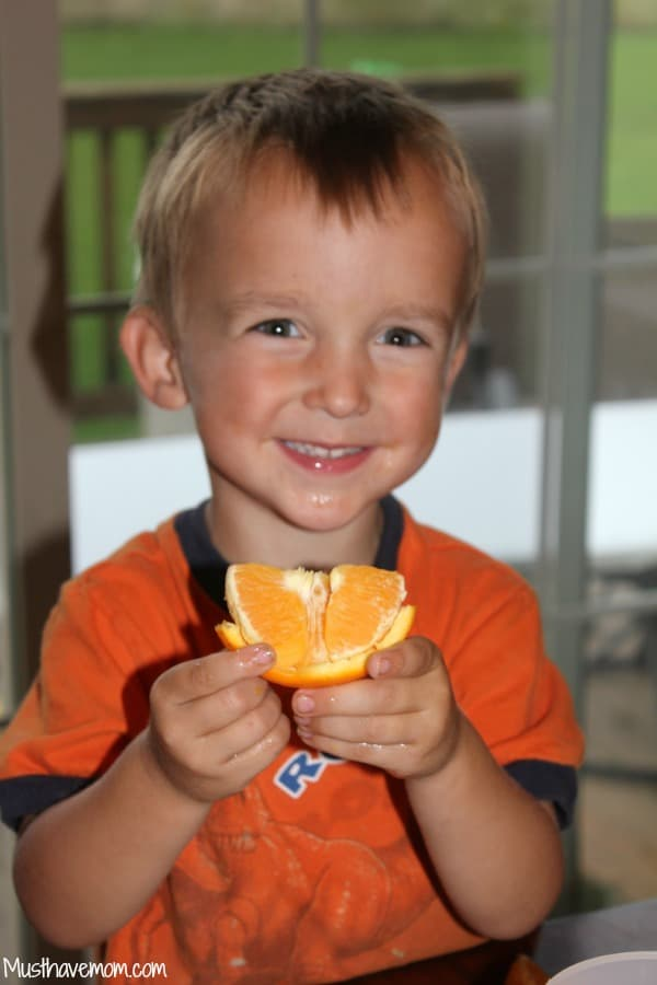 Carson eating a Florida orange