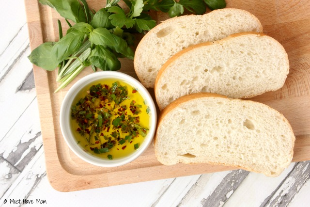 Tuscan Herb Dipping Oil Recipe. SO amazing! Pair with bread for dipping and it tastes like the herb oil you get at fancy restaurants. Easy entertaining idea or hostess gift!