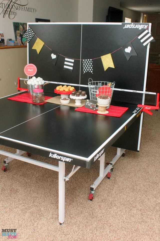 Valentine's Day Date Night In Idea with free printables! Have a fun ping pong date night at home. Free ping pong ball printables to create your themed date night. No sitter on Valentine's Day doesn't mean you can't have a fun date night at home!