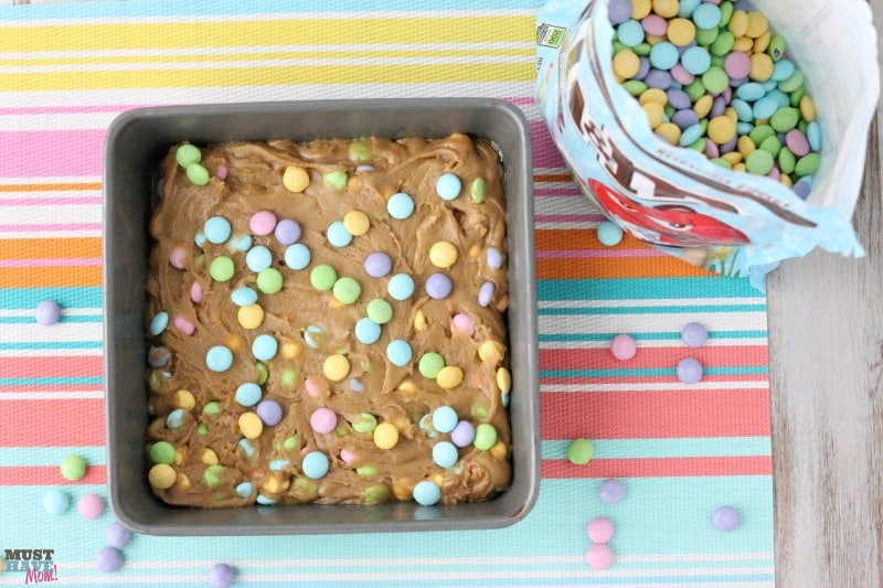 Easter M&M Cookie Bars Recipe. Easy and SO delicious! Perfect for a quick Easter dessert recipe idea. Use pastel M&M's to make these or any other holiday colored M&M's!