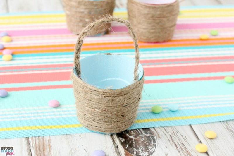 DIY Mini Easter Basket idea using a plastic cup and jute. Transform a cup into a beautiful mini easter basket and fill it with mini candy bars!