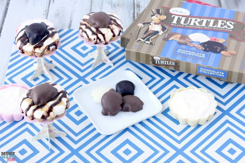 Chocolate and Caramel TURTLES® easy mini cheesecakes recipe! These no bake mini cheesecakes are the perfect easy dessert idea! Quick easy dessert that looks fancy!