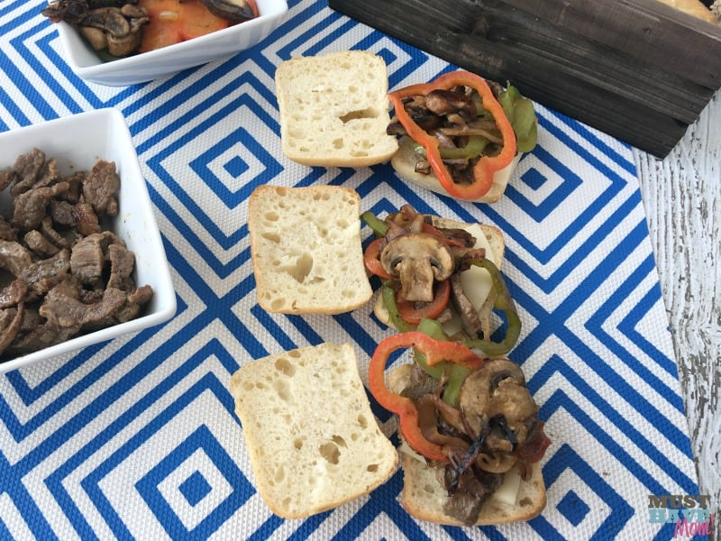 Easy 30 minute Philly Cheesesteak Burgers! Mix up your 4th of July food with this fun idea that you can even make ahead and warm later!