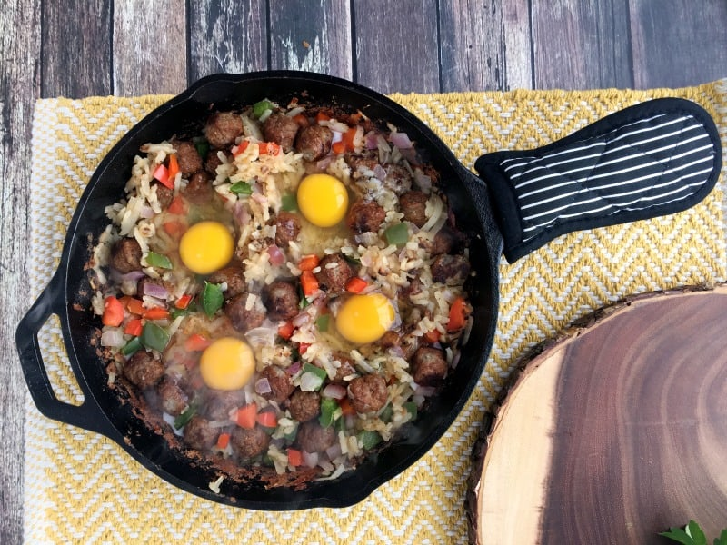 Easy one skillet sausage and egg breakfast hash recipe. Quick and easy breakfast with hashbrowns, eggs, sausage meatballs, veggies combined in a one pot meal! Hearty breakfast and can make it over a campfire too!