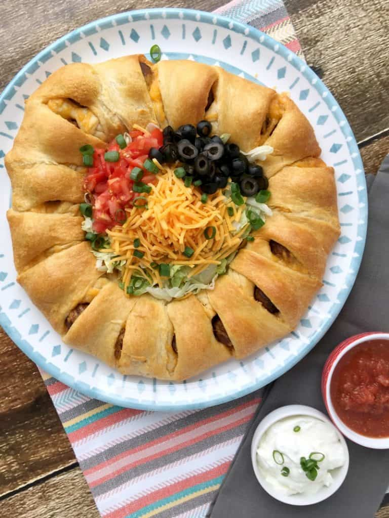 Easy Meatball Taco Ring Recipe! Great weeknight recipe idea or party food idea! Could be served as an appetizer or a meal. Crowd pleasing recipe! Easy recipe to whip together and have done in 30 minutes or less!