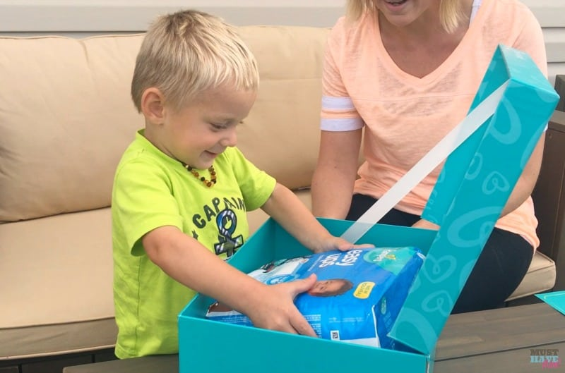 Pampers surprise box unboxing by toddler