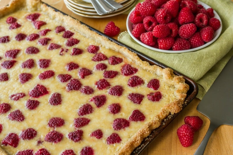 Raspberry Buttermilk Slab Pie Recipe. Perfect raspberry recipe to use up those summer berries! Dessert recipe that can serve a crowd!