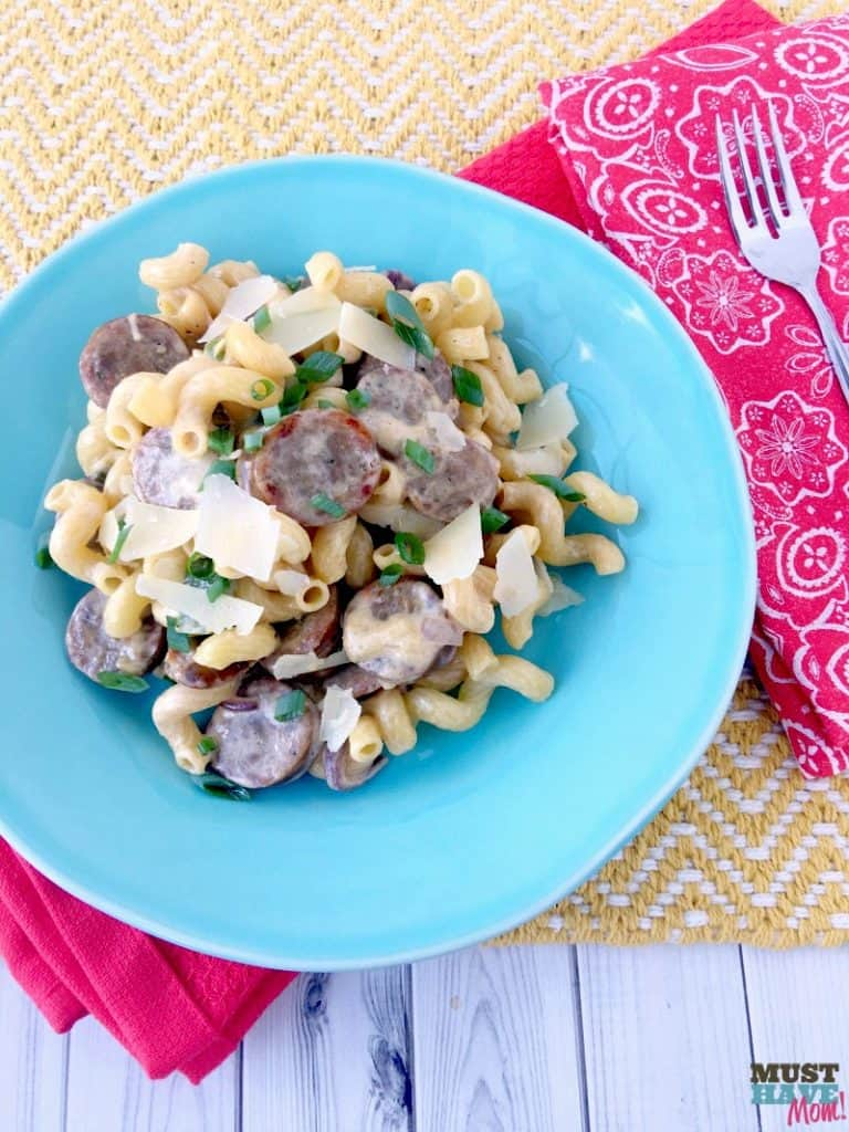 20 Minute Sausage and Pepper Cajun Alfredo recipe! Make this 2 ingredient alfredo sauce with sausage, peppers and onions for a quick weeknight meal idea!