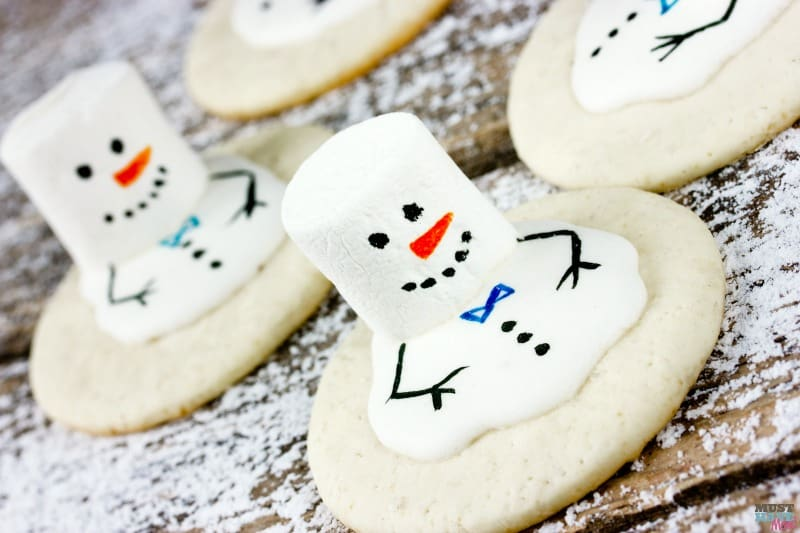 Melting snowman cookies recipe. Great kids Christmas cookie idea. These melted snowman cookies will put a smile on your face!