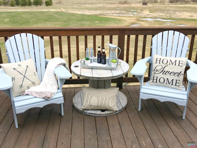How to DIY farmhouse style adirondack chairs. Build them, paint them and style them! She shows you how. Bring farmhouse decor outdoors!