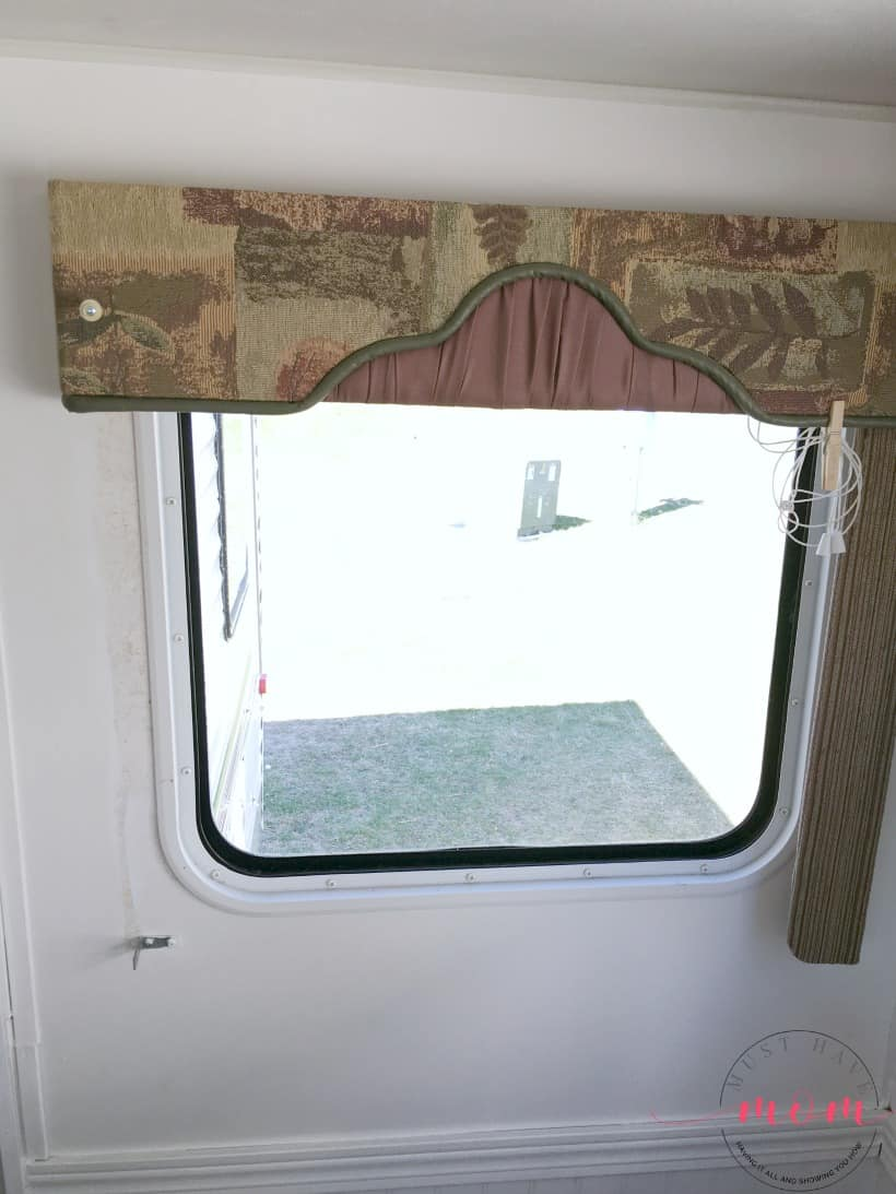 How to remove outdated RV window coverings from your camper. It's easy to remove rv window valances and let light in!