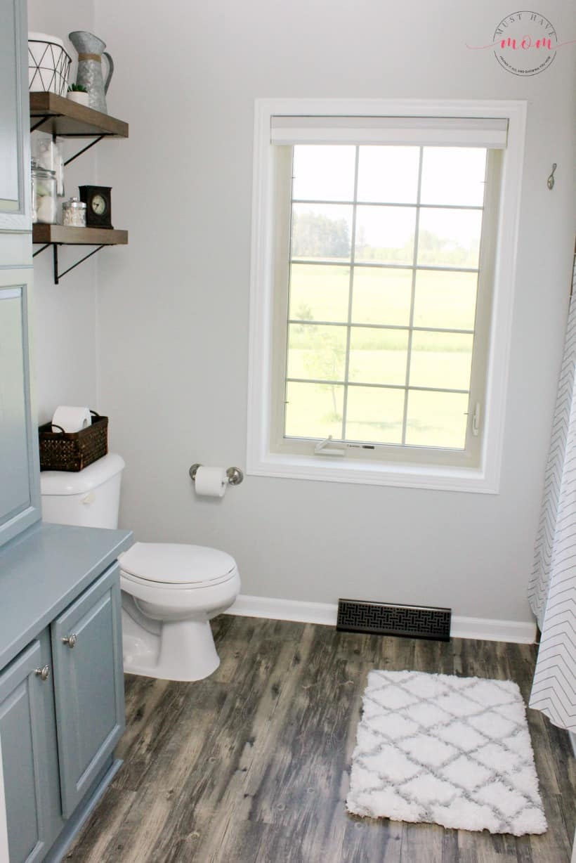 DIY farmhouse style bathroom. Use layering to achieve a fixer upper style bathroom.
