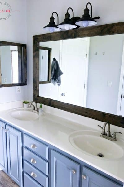 Builder grade mirror makeover. How to build a rustic farmhouse style mirror frame for your bathroom.