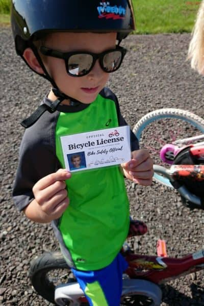 Teach your kids bike safety through play! Fun activity to decorate bike helmet, free printable bicycle license and cone course!