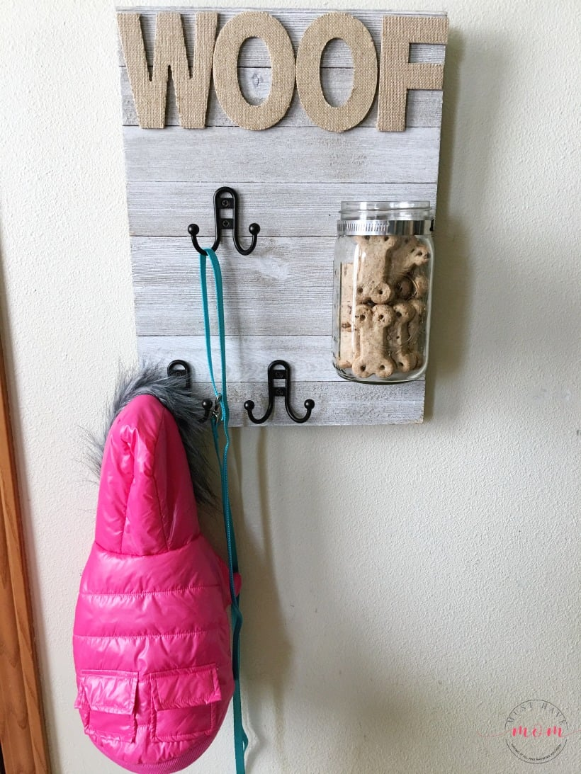 DIY Dog sign with treat jar and dog leash holder! Make this fun dog treat jar pet sign that is functional and adorable!