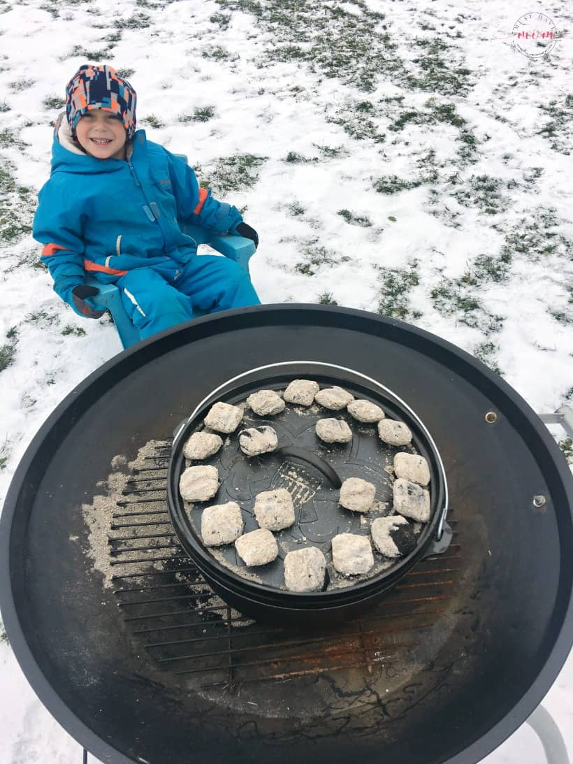 dutch oven with coals on lid