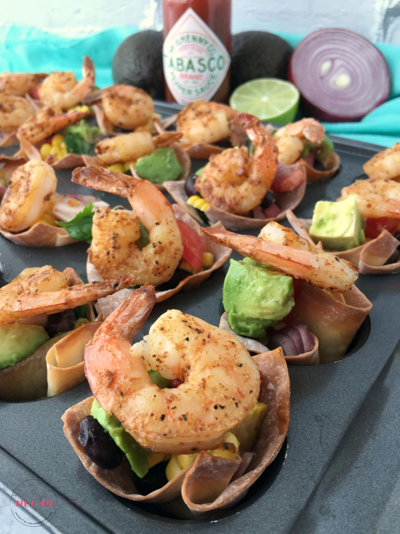 Spicy shrimp wonton cups with black bean corn avocado guacamole. Great party appetizer for the big game!