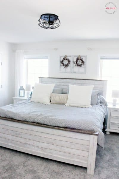 farmhouse bedroom with hypoallergenic carpet. Great fixer upper bedrooms style and colors.