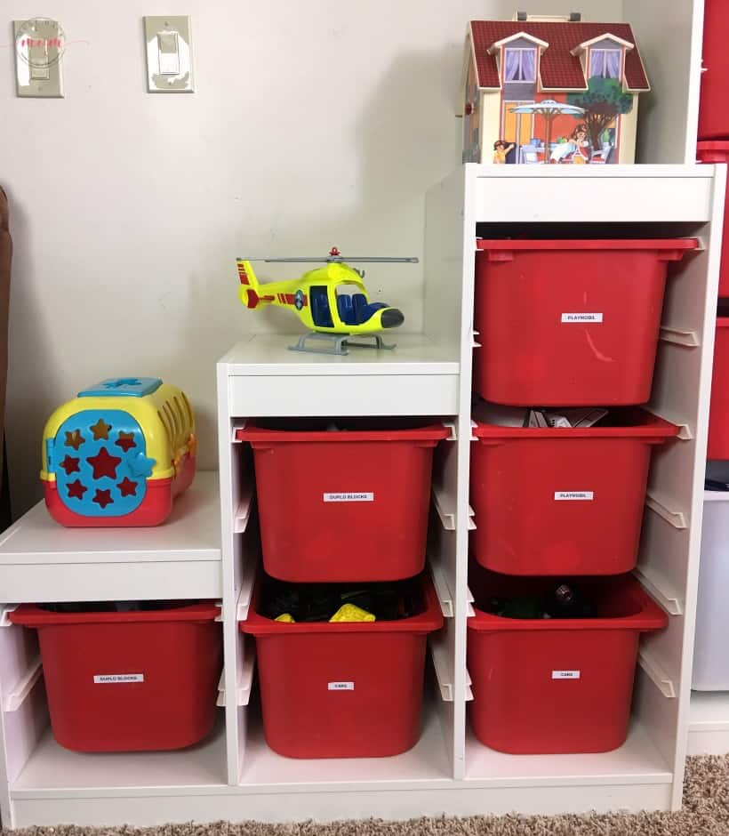 Playroom organizing tips plus how to pare down toys and see how less toys equals MORE play!