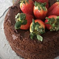 Paleo chocolate cake recipe! Layered chocolate cake topped with strawberries. With superfood addition that my kids love!