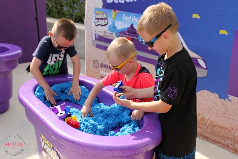 kids playing with kinetic sand