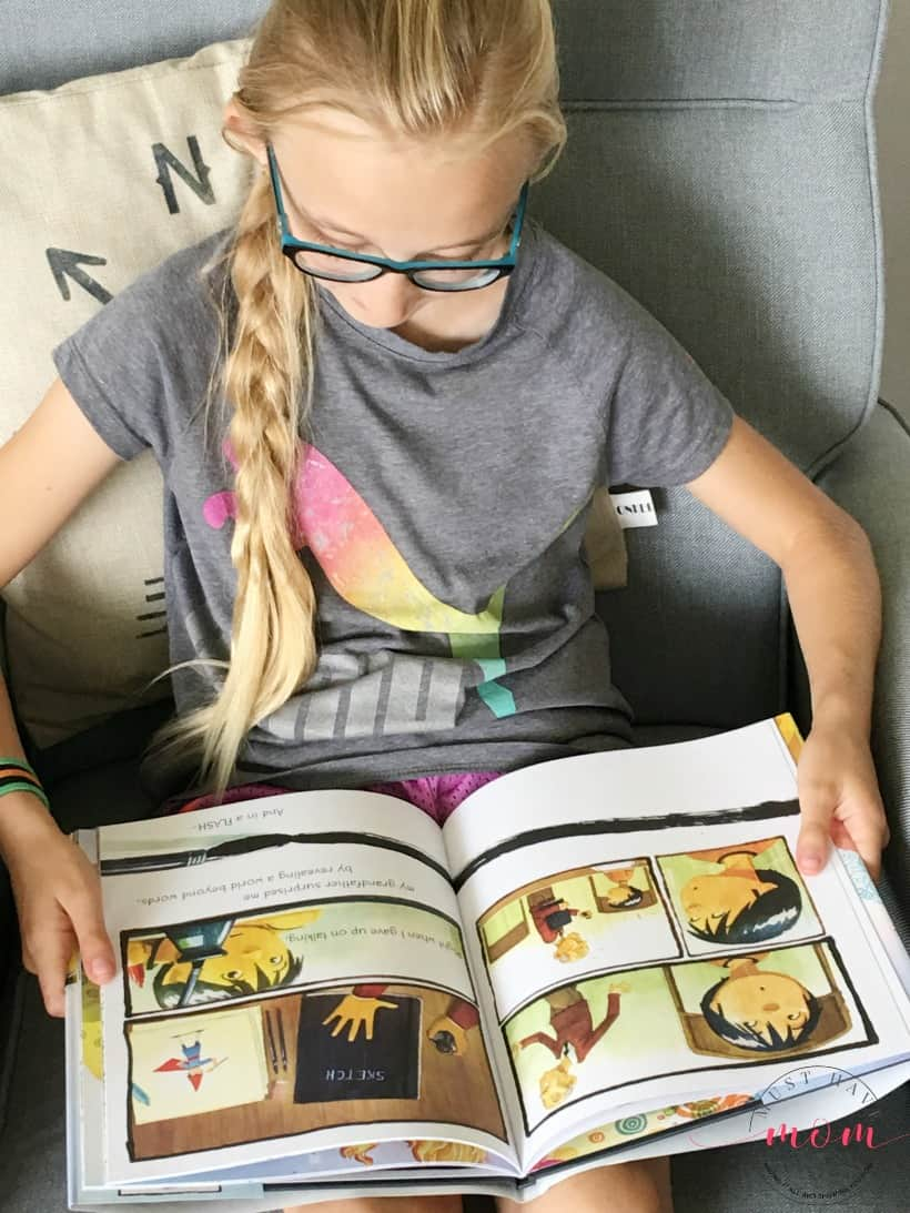child reading Drawn Together