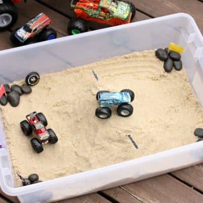 DIY Monster Truck Stadium Sensory Bin + Monster Truck Toys