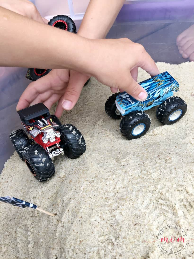 boys playing with monster trucks