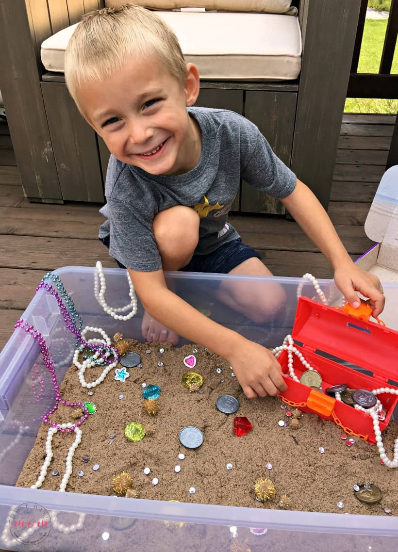playing treasure hunt sensory bin