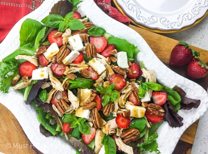 This Strawberry Chicken Salad is loaded with feta, pecans and a honey dijon dressing. Make the chicken in the Instant Pot for a fast, delicious meal.