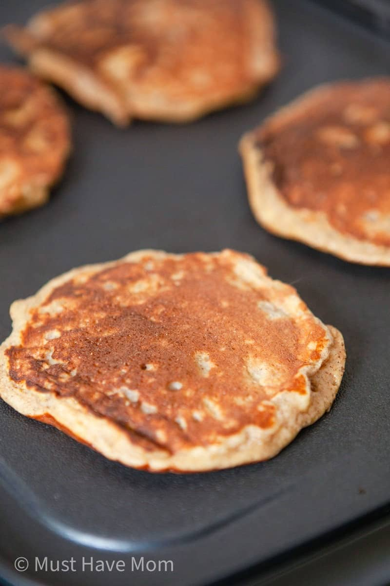 cook dairy free pancakes on a griddle