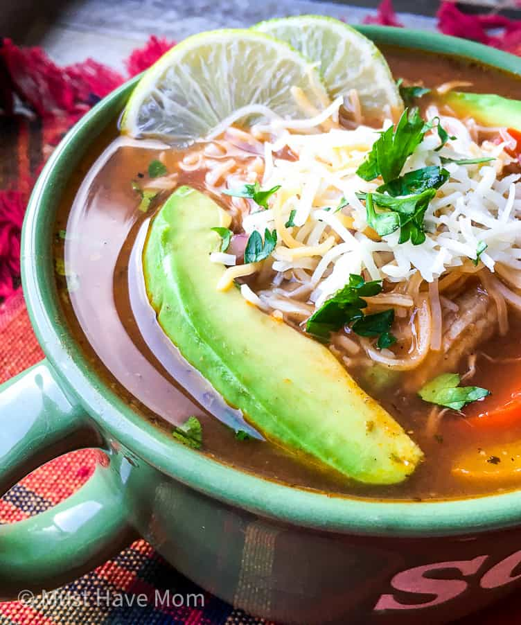 chicken fajita soup with avocado cheese and lime