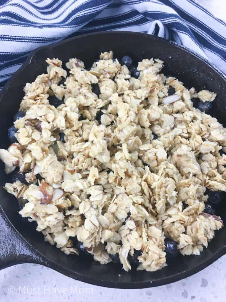 blueberry cobbler in cast iron pan