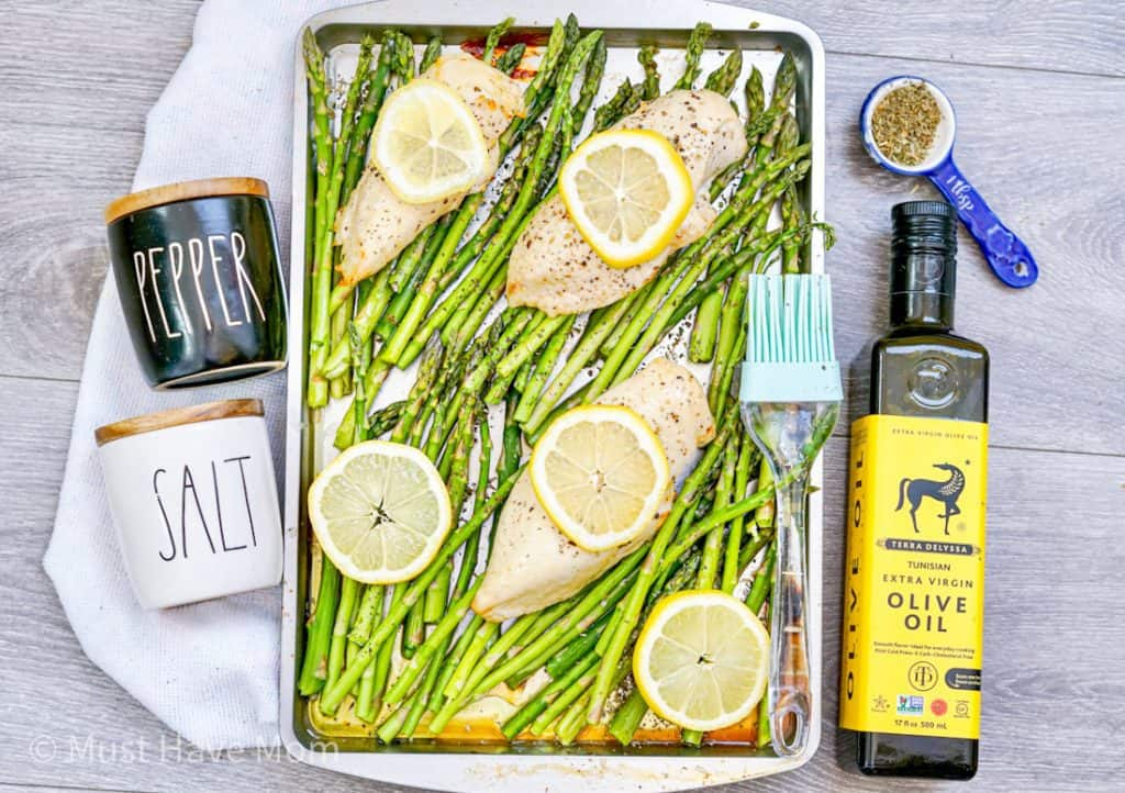 put chicken and asparagus on a sheet pan